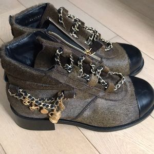 CHANEL pony hair booties with charm detail